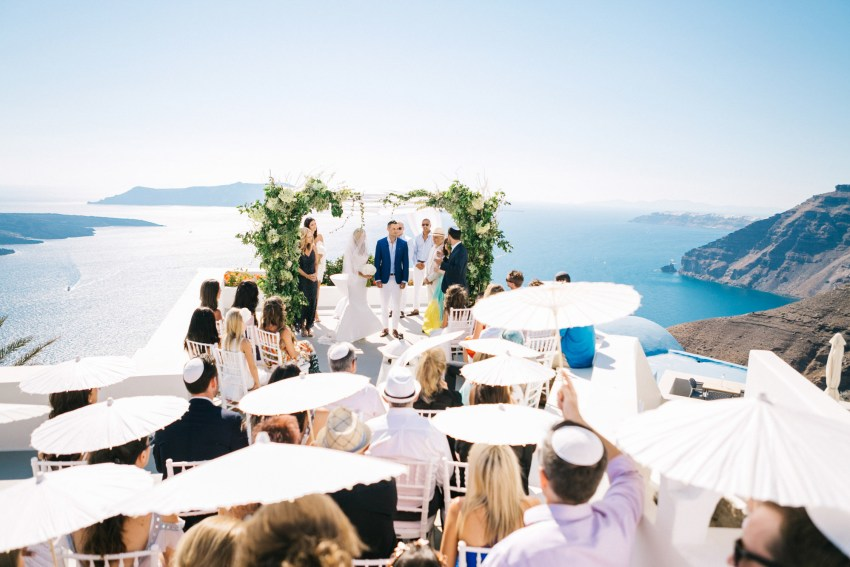 Wedding ceremony view in Santorini caldera.