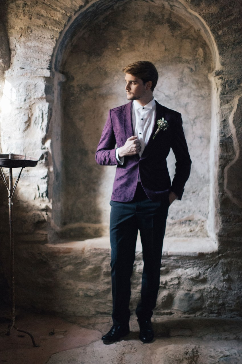 Groom wearing fancy suit and styled for wedding in Greece
