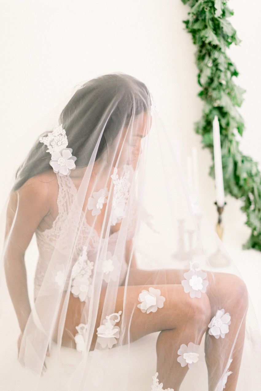 Stunning bride in Intimissimi lingerie during wedding boudoir inspiration session in Loyal Villas Luxury villa in Mykonos island, Greece.