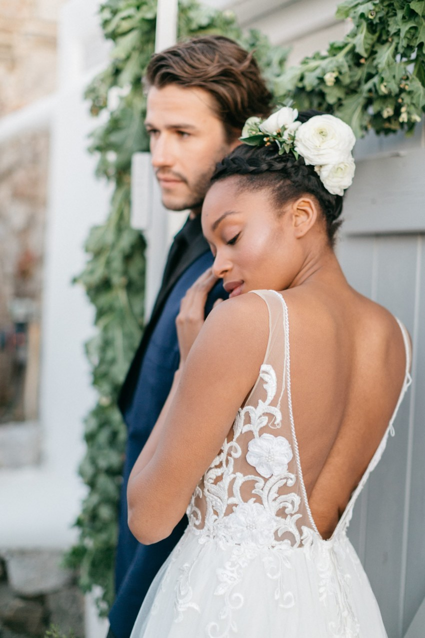 Beautiful bride and groom at a white villa wedding inspiration session by DeplanV in Loyal Villas Luxury, Mykonos, Greece.