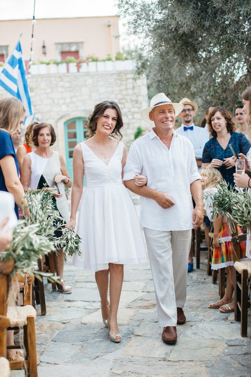 Traditional destination wedding ceremony with a donkey at Grecotel Agreco Farm Crete Greece.