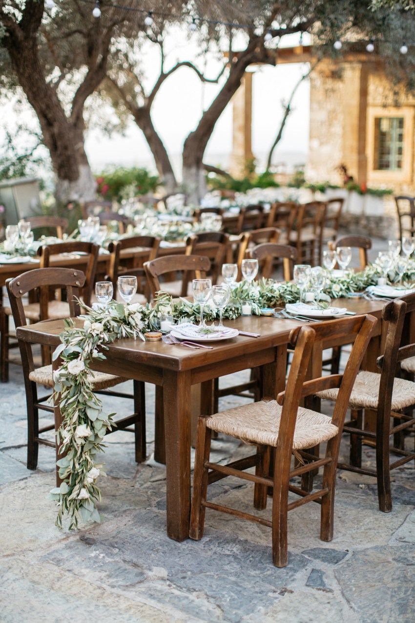 Rustic and elegant wedding reception setup at St. Nicolas church at Grecotel Agreco Farm Rethymno Crete.