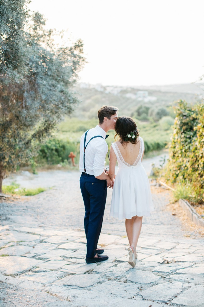 Happy newlyweds, bride and groom, at Grecotel Agreco Farm Crete Greece.