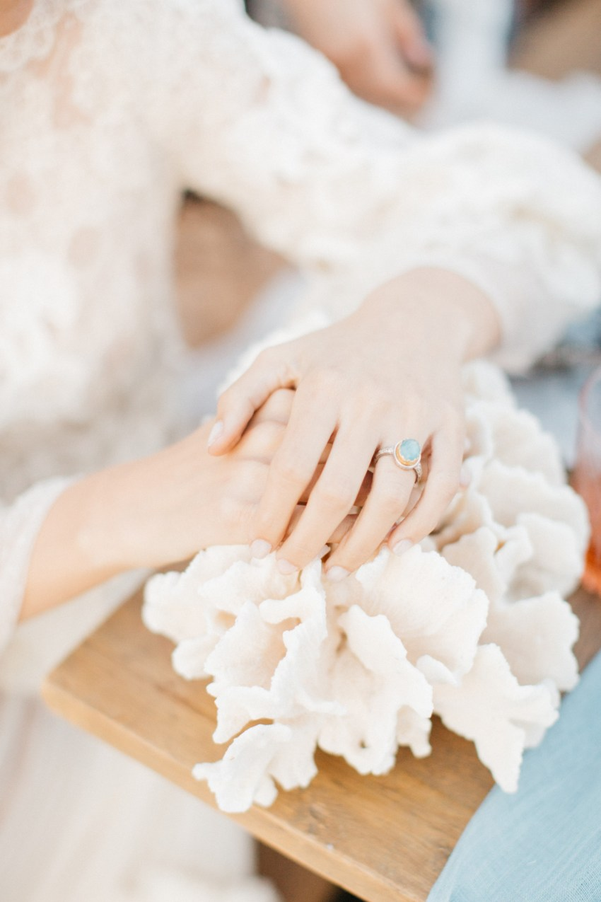 One-of-a-kind jewelry pieces of Santorini wedding stative inspiration session on the beach.
