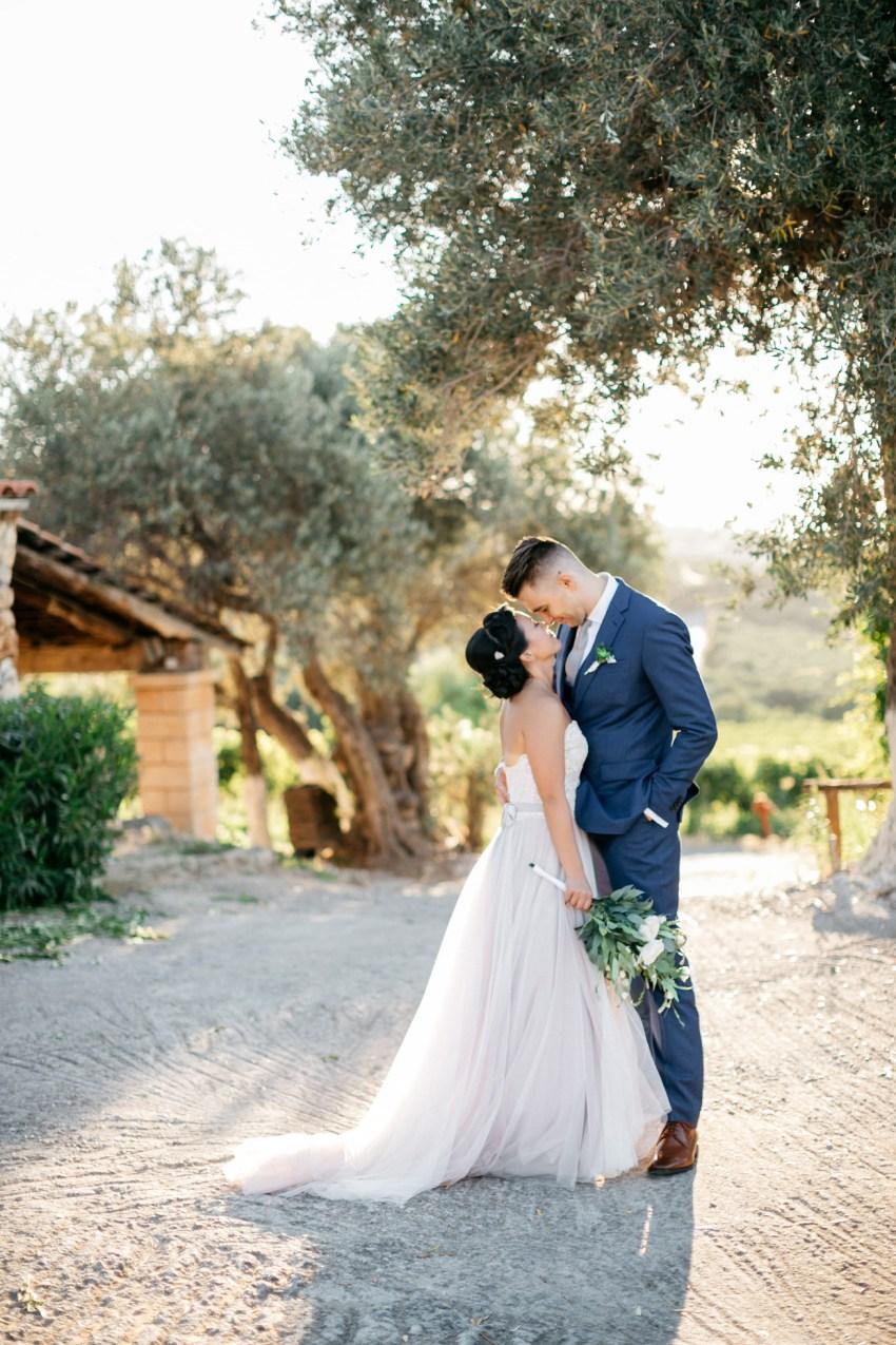 Bride and groom at their vineyard destination wedding in Agreco Farms, Grecotel, Crete, Greece.