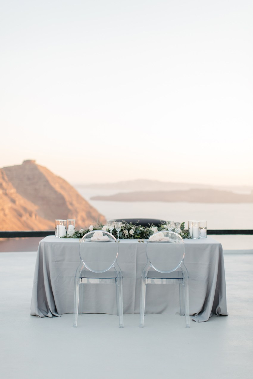 Elegant wedding dinner setup in Aenaon Villas in Oia Santorini Greece.