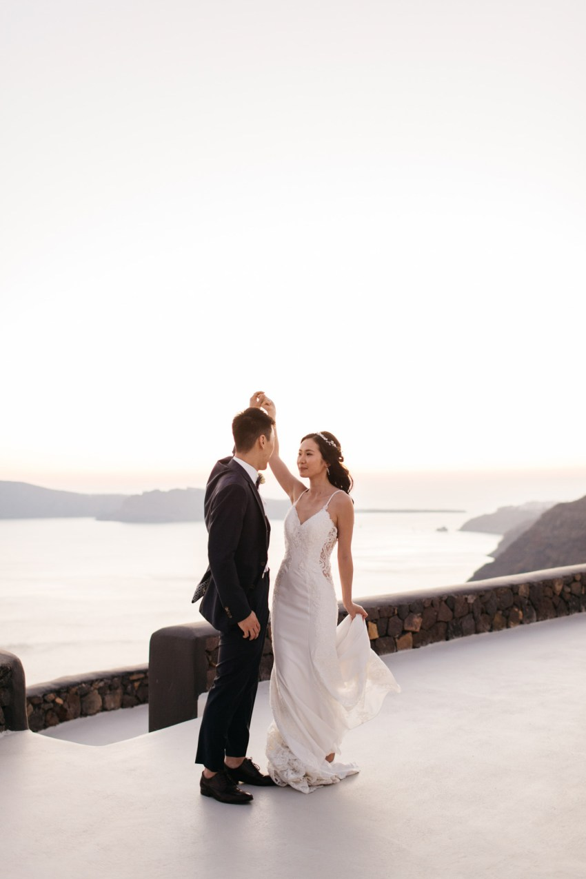 Intimate destination wedding in Aenaon Villas in Oia Santorini Greece.