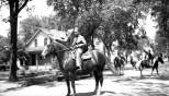 David D. Hanneman prepares to ride a horse in a Mauston parade, circa 1942.