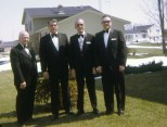 Carl F. Hanneman with his son David (two at left) at the Hanneman home in Sun Prairie before David became a Sir Knight on April 14, 1973.
