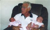 Looking just a little overwhelmed with granddaughters Ruby and Maggie Hanneman