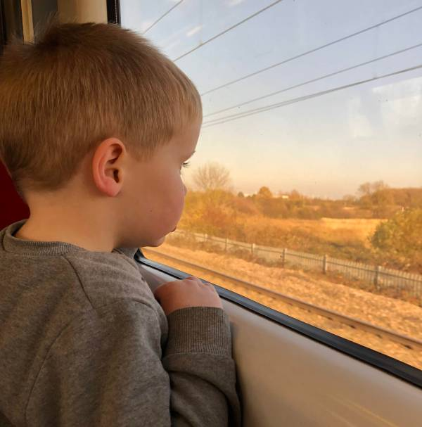 Jaxon watching the world go by on the train