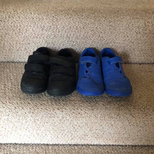 Jaxon's black school shoes and his blue trainers on the stairs