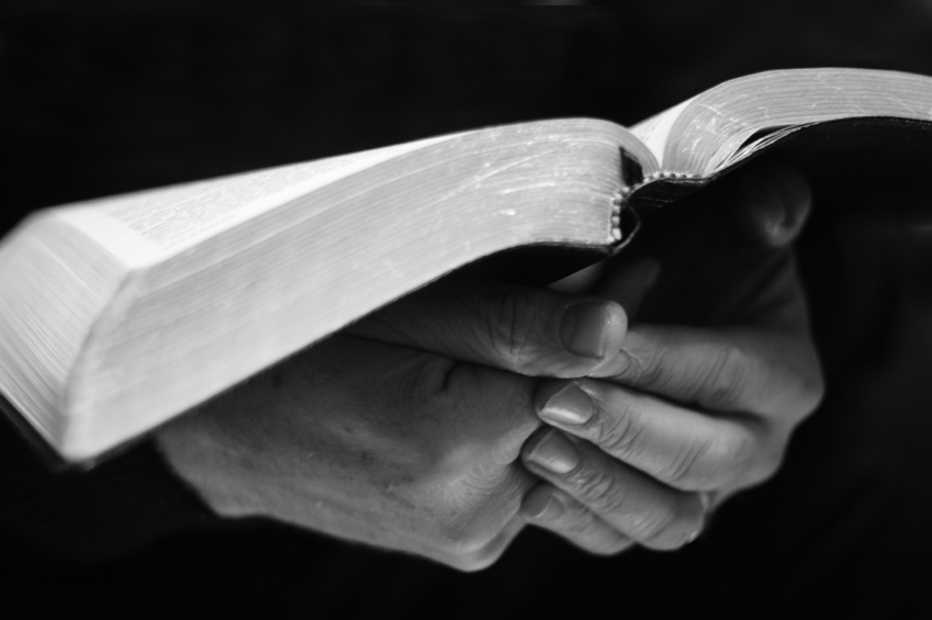 Hands Holding Bible | Hansen-Spear Funeral Home - Quincy, Illinois