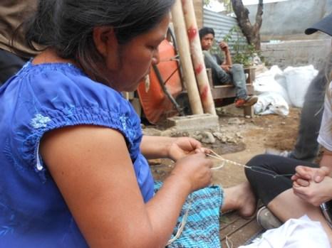 polina making bracelets
