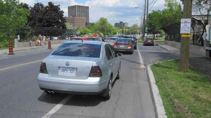 cars on bike lane in Ottawa