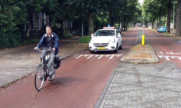 A bike street in Utrecht, Netherlands running along the Rietveldhuis.