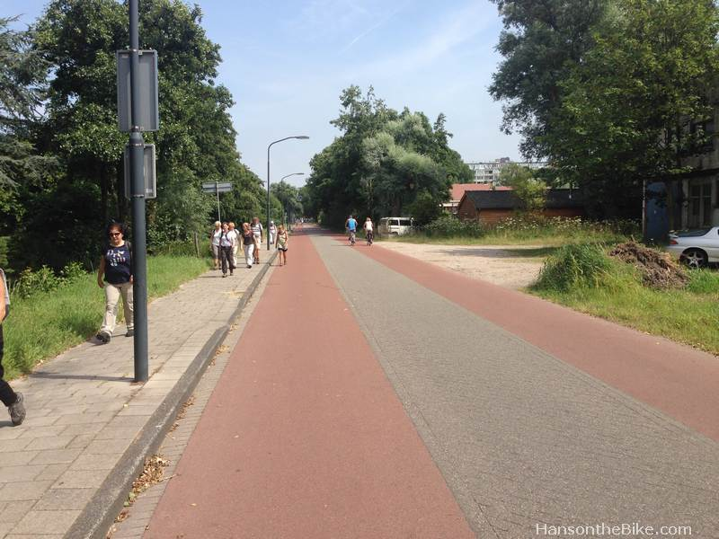 Advisory lanes in Haarlem. This street connects with a solar powered ferry over the Spaarne river, further feeding cyclists into the core.