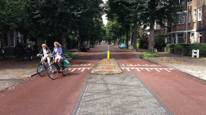 Bicycle Street in Utrecht, Netherlands in front of the Gerrit Rietveld huis. Note that the bike street still has a refuge too.