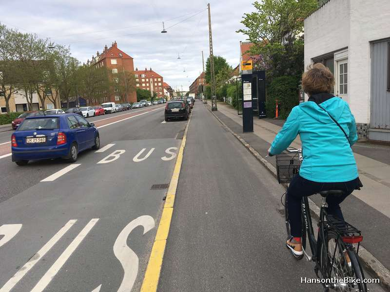 About 4 km from downtown. Raised bike lane into town along Valby Langgade. Note the bike lane is raised and the sidewalk is not only slightly separated with a paved strip but also raised again. People cycle between the bus and the bus stop.