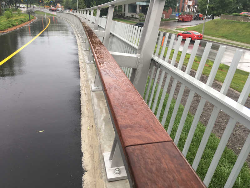 wooden railing at Flora Footbridge