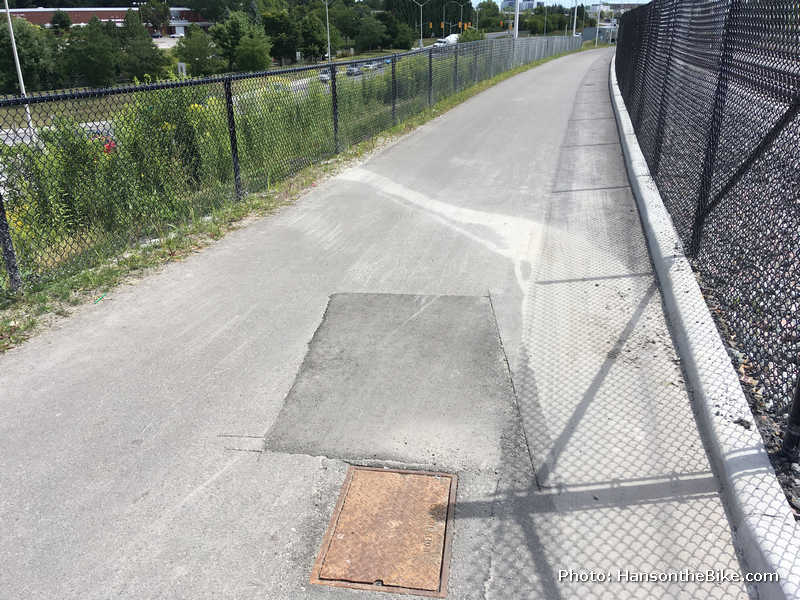 Unfortunately, there are already several cuts made in the new pavement, accelerating the deterioration of the pavement