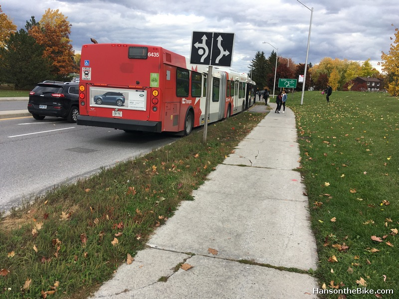 The bus picking up students. This stretch of the Brookfield should be see a lot of mixed use of students boarding buses and cyclists passing but other places in Ottawa (Pimisi, UOttawa) seem to handle that fine