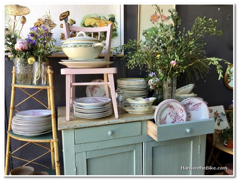 fleamarket dishes on cupboard