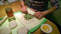 Roll the scallions in