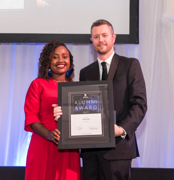 Wawira Njiru receiving the award from UNISA's vice chancellor David Lloyd.