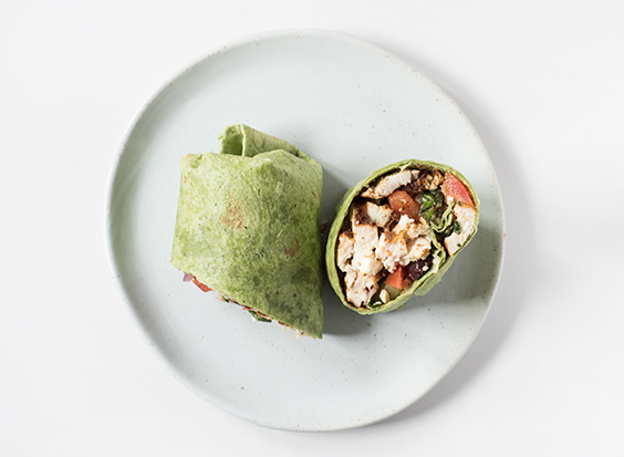 Mediterranean Chicken Wrap - light with crispy veggies, juicy spice-rubbed chicken, all wrapped up in a spinach tortilla. It has so much flavor, you won't even realize you're eating healthy!