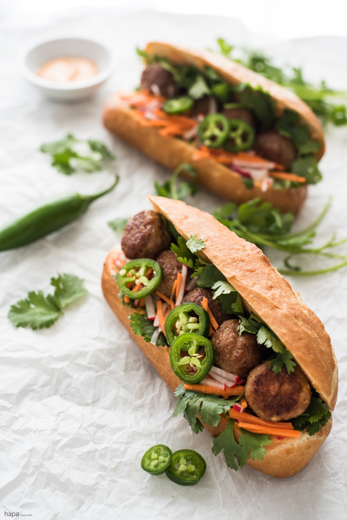 Incredibly moist and flavorful Meatball Bánh Mì Sandwich with fresh veggies and creamy Sriracha mayo on a crispy bun.