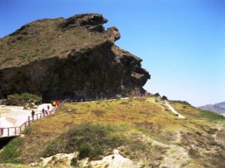View from the road of tourists making their way to Marneef Cave