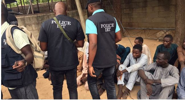 suspected kidnappers paraded by the men of the Inspector General's Intelligence Response team in Borno