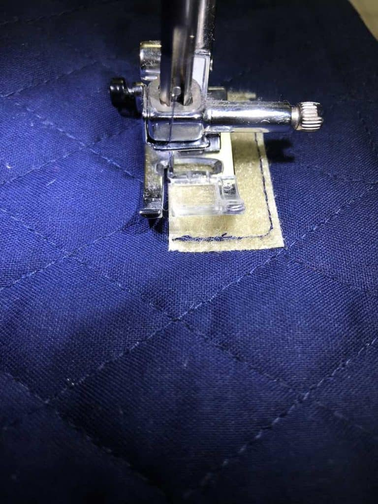 Sew the soft pieces of Velcro into place