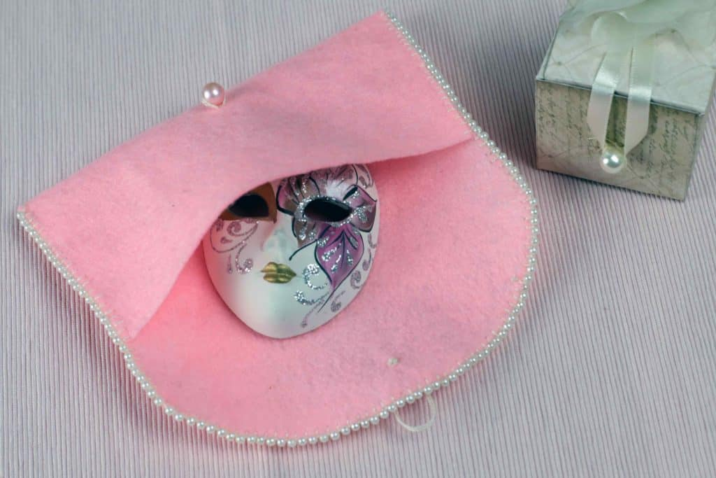 Completed Felt Coin Purse with object inside.