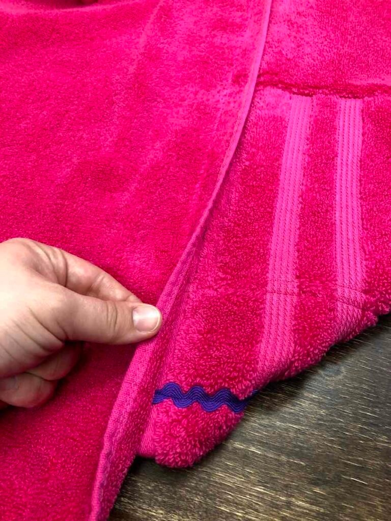 Flip towel over and stitch along towel edge