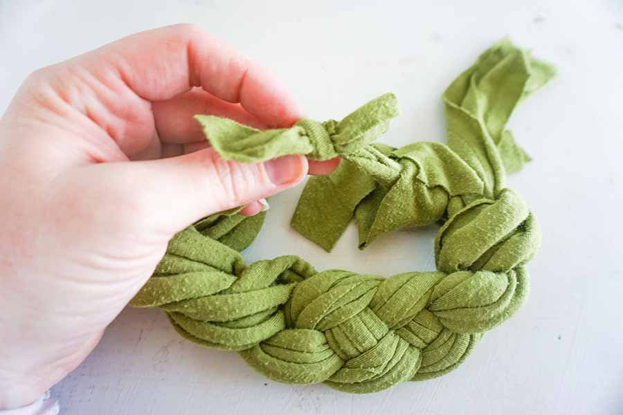 tying sailor's knot headband together