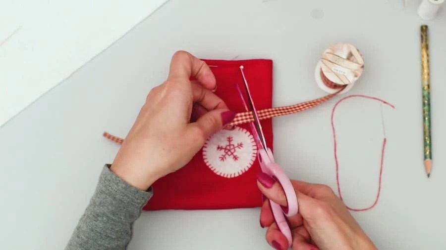 Cut a piece of ribbon for DIY Mini Stocking Gift Card Holder