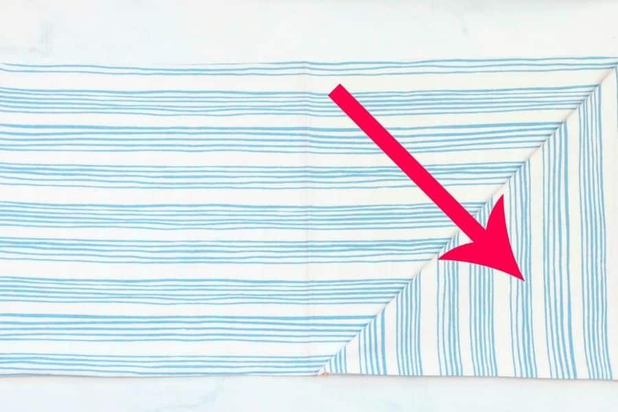 arrow showing correct side of fabric