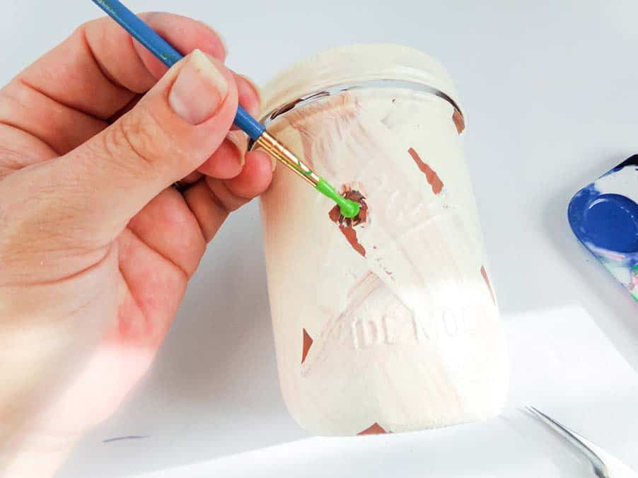 painting eye on mummy jar