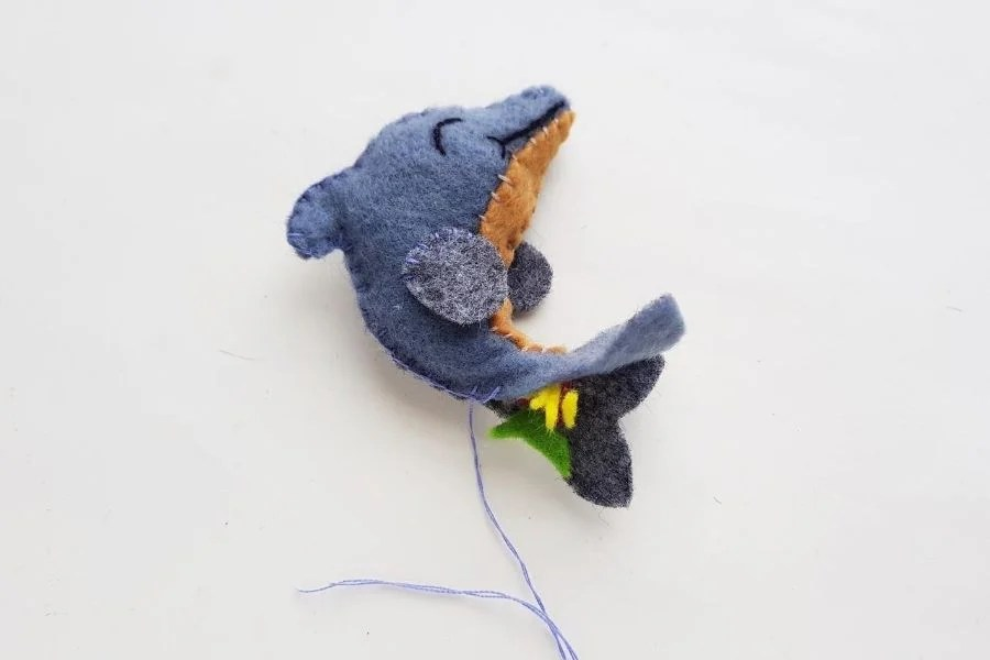 stuffing and sewing up the dolphin