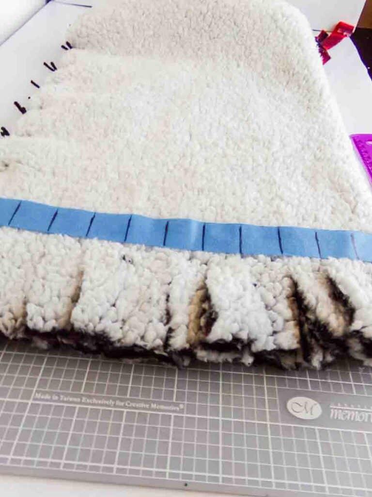 cutting tassels No-Sew Fleece Hat