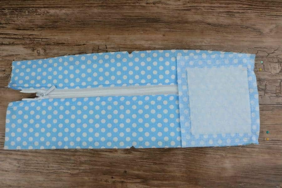 """From the right side (zipper end side) line the 3"""" ¾ x 3"""" ¼ with the edge of the fabric"""