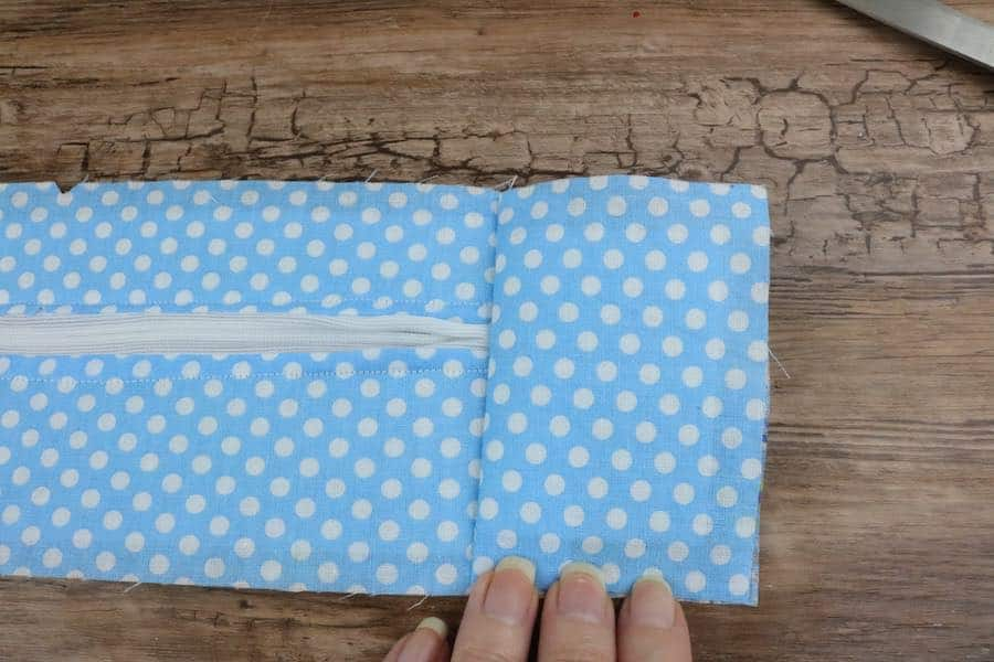 Unfold the flap so that it is lined/matched to the fabric of its side