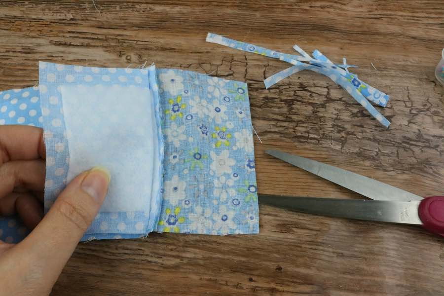 From the interior seam edges, trim excess fabric