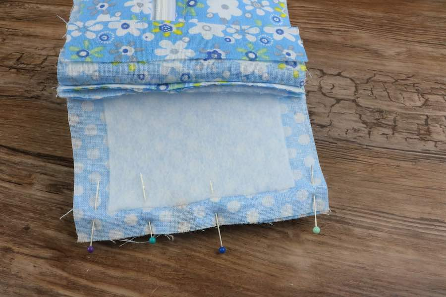 Now pin that top fabric fused piece to the end of the other end of the zipper for makeup case