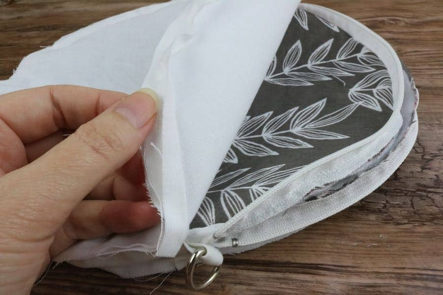 Put the outer round purse into the lining