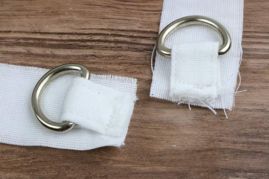 Sew both tabs several times