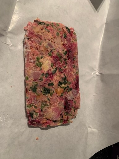 An example of what Cola's Kitchen Customized cooked dog food looks like Frozen.