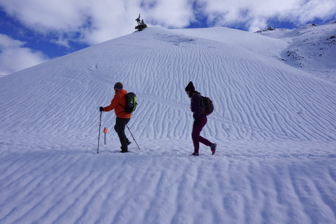 Winter hiking in Garibaldi Provincial Park. Find out how to stay safe in the mountains in the winter with these 8 tips for winter hiking.